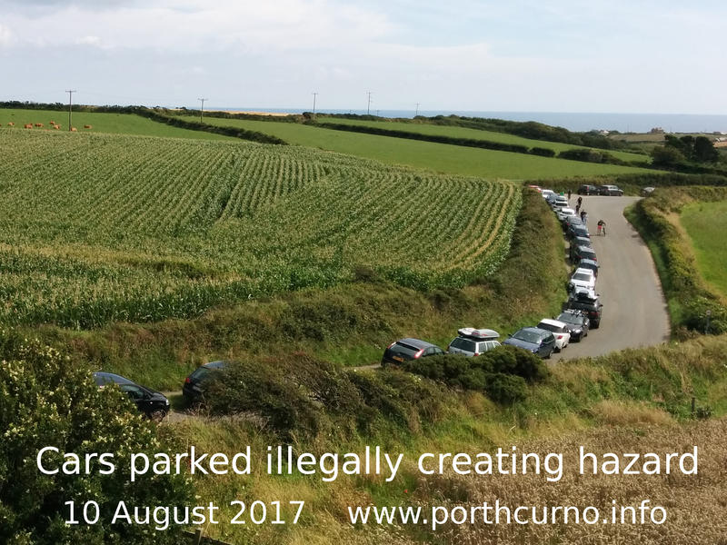 Cars parked on pavement on road to Porthcurno