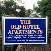 The Old Hotel Apartments sign and building Porthcurno
