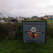 Lands End campsite field and sign