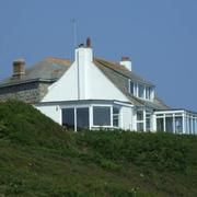 View of Vessacks holiday home on hill at Porthcurno