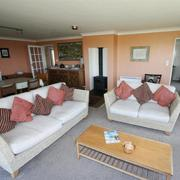 Sitting room of holiday home at Porthcurno